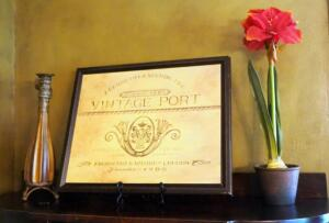 "Framed Vintage Port Sign, 22"" x 18"" With Stand, Vase, And Amaryllis Silk Arrangement"