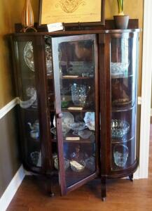 "Antique Curved Glass Curio Cabinet On Casters, With Key, 4 Wood Shelves, 61"" X 42"" X 14, Contents Not Included, 2nd Day Loadout Only"