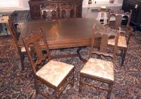 "Intricately Carved Old English / Jacobean Dining Room Table And Matching Chairs, Qty 2 Captain's Chair, Qty 4 Dining Chairs, One Chair Damaged, 30.5""H"