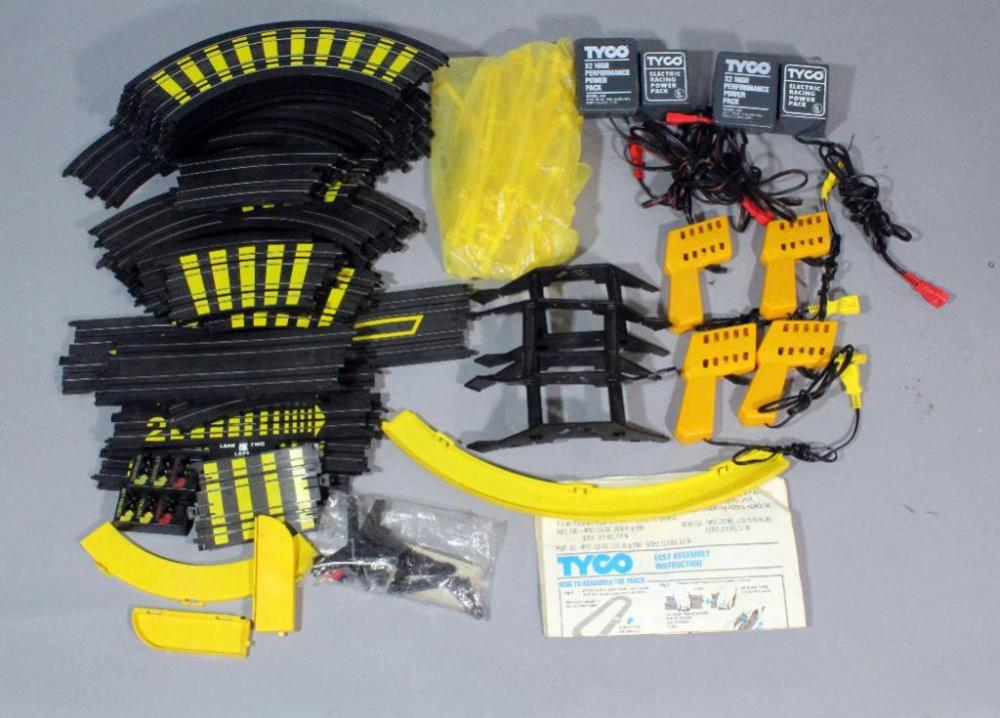 lot 299 of 357: tyco model 630 slot car track with cars and power supply,  see photos
