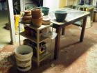 Gardening Table Including Terra Cotta Flower Pots, Hanging Baskets, Metal Rolling Shelf And More