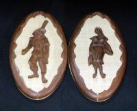 Pair Of Carved Relief Figures On Woven Background